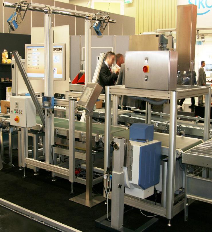 Post-Expo 2012: Bizerba präsentiert automatisches System zum Dimensionieren, Wiegen und Scannen (DWS)